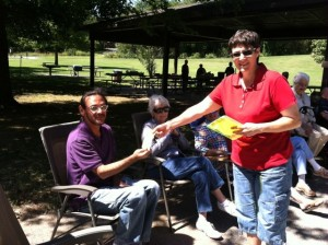 2015 Picnic--Dianna handing Gene his Prize